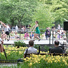 Once the clock struck half past six the show began. This was a park wide event in which the dancers were putting on a performance in 3 different area's of the park all at once. Liking the dancers as well as the early summer flower show, I walked around until I finally found a spot where I could capture the crowd the performers and some flowers all in one shot.