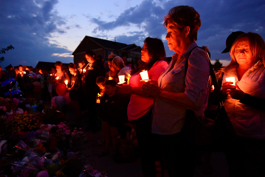 . FREDERICK, CO - AUGUST 17: Rita Medina, second from right, and Louanne Medina, third from right, both of Johnstown, stand in silence during a candle light vigil for Shanann, Bella and Celeste Watts in front of their home on the 2800 Block of Saratoga Trail in Frederick on Aug. 17, 2018. Christopher Watts is being held without bond after allegedly admitting to killing his wife and daughters.  (Photo by Matthew Jonas/Staff Photographer)