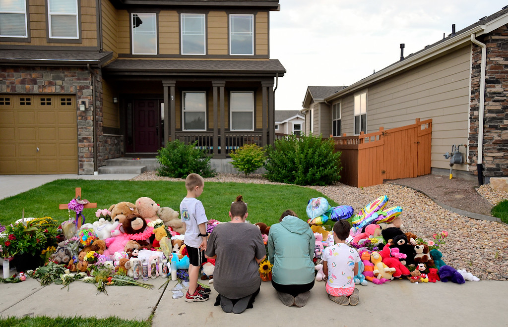 . FREDERICK, CO - AUGUST 17: From left: Asher Dhooge, 5, Alyssa Dhooge, Brandi Banning, and Aubriee Dhooge, 8, kneel before a growing memorial for Shanann, Bella and Celeste Watts in front of their home on the 2800 Block of Saratoga Trail in Frederick on Aug. 17, 2018. Christopher Watts is being held without bond after allegedly admitting to killing his wife and daughters.  (Photo by Matthew Jonas/Staff Photographer)
