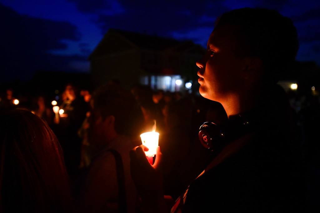 . BEST2 FREDERICK, CO - AUGUST 17: Alexi Fehrmann, of Frederick, stands in silence during a candle light vigil for Shanann, Bella and Celeste Watts in front of their home on the 2800 Block of Saratoga Trail in Frederick on Aug. 17, 2018. Christopher Watts is being held without bond after allegedly admitting to killing his wife and daughters.  (Photo by Matthew Jonas/Staff Photographer)