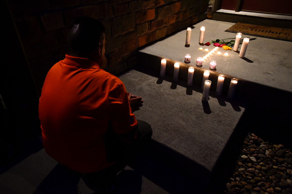 . FREDERICK, CO - AUGUST 17: Matthew Gasca, of Denver, kneels and prays during a candle light vigil for Shanann, Bella and Celeste Watts in front of their home on the 2800 Block of Saratoga Trail in Frederick on Aug. 17, 2018. Christopher Watts is being held without bond after allegedly admitting to killing his wife and daughters.  (Photo by Matthew Jonas/Staff Photographer)