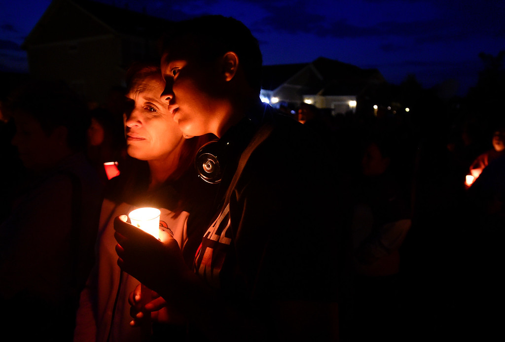 . FREDERICK, CO - AUGUST 17: From right: Alexi Fehrmann and her mother Marissa Fehrman, both of Frederick, stand in silence during a candle light vigil for Shanann, Bella and Celeste Watts in front of their home on the 2800 Block of Saratoga Trail in Frederick on Aug. 17, 2018. Christopher Watts is being held without bond after allegedly admitting to killing his wife and daughters.  (Photo by Matthew Jonas/Staff Photographer)