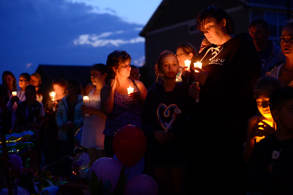 . FREDERICK, CO - AUGUST 17: Hundreds gather during a candle light vigil for Shanann, Bella and Celeste Watts in front of their home on the 2800 Block of Saratoga Trail in Frederick on Aug. 17, 2018. Christopher Watts is being held without bond after allegedly admitting to killing his wife and daughters.  (Photo by Matthew Jonas/Staff Photographer)