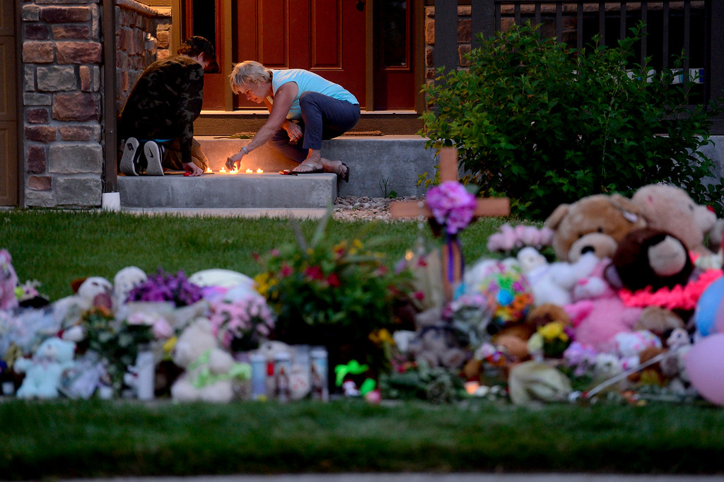 . FREDERICK, CO - AUGUST 17: From left: Olin DeClerck, and Mary Ann Bogner, both of Frederick, light candles on the porch during a candle light vigil for Shanann, Bella and Celeste Watts in front of their home on the 2800 Block of Saratoga Trail in Frederick on Aug. 17, 2018. Christopher Watts is being held without bond after allegedly admitting to killing his wife and daughters.  (Photo by Matthew Jonas/Staff Photographer)