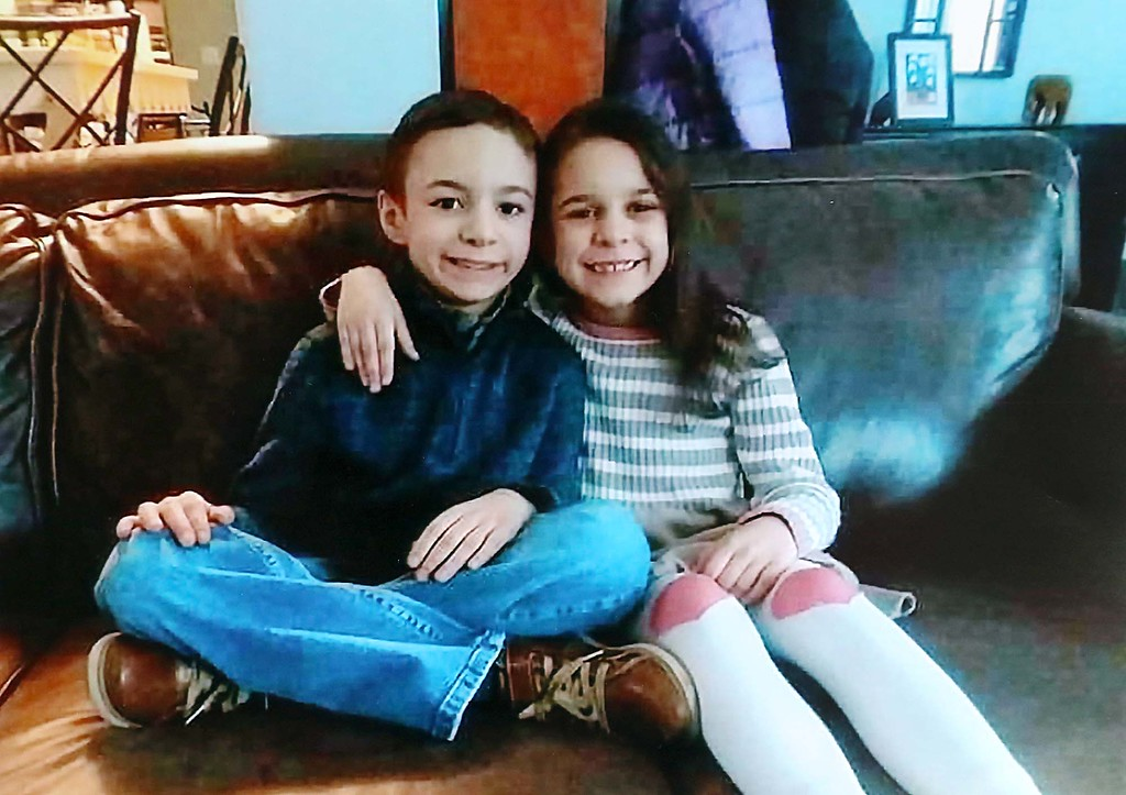 . This picture of Sofia Brito, 6, who has passed away and Julian Brito, 9, who is still in the hospital hung at the candle light vigil for them on Friday night at Riverfront Park in Fitchburg. SENTINEL & ENTERPRISE/JOHN LOVE