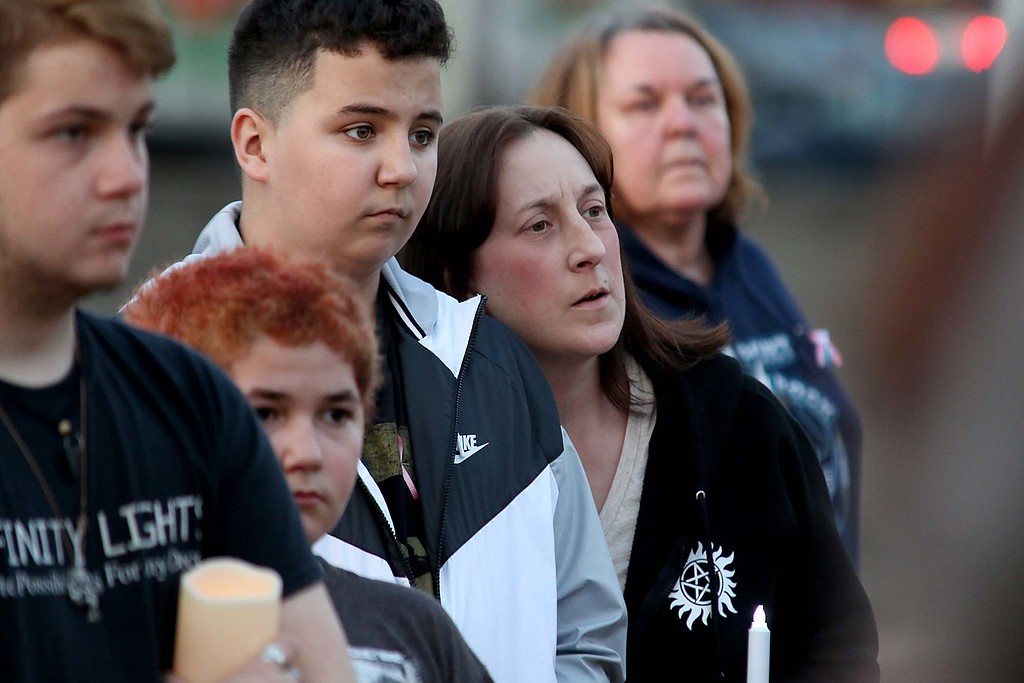 . Patti lane and her son Davian Thbodeau, 13, both from Fitchburg listen to speakers at the candle light vigil for Sofia Brito, 6, who has passed away and Julian Brito, 9, who is still in the hospital on Friday night at Riverfront Park in Fitchburg. SENTINEL & ENTERPRISE/JOHN LOVE