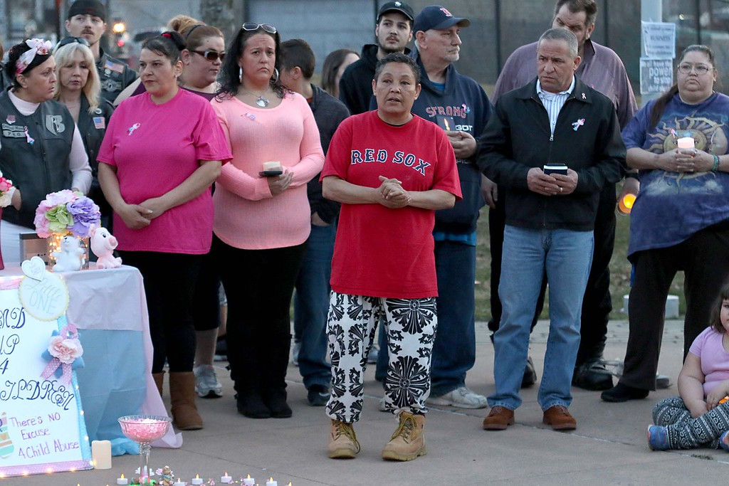 . Zumla Malave, in Red Sox shirt, addresses the crowd at the candle light vigil for Sofia Brito, 6, who has passed away and Julian Brito, 9, who is still in the hospital on Friday night at Riverfront Park in Fitchburg. SENTINEL & ENTERPRISE/JOHN LOVE