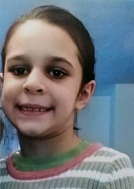 . This picture of  Sofia Brito, 6, who has passed away hung at the candle light vigil on Friday night at Riverfront Park in Fitchburg. SENTINEL & ENTERPRISE/JOHN LOVE