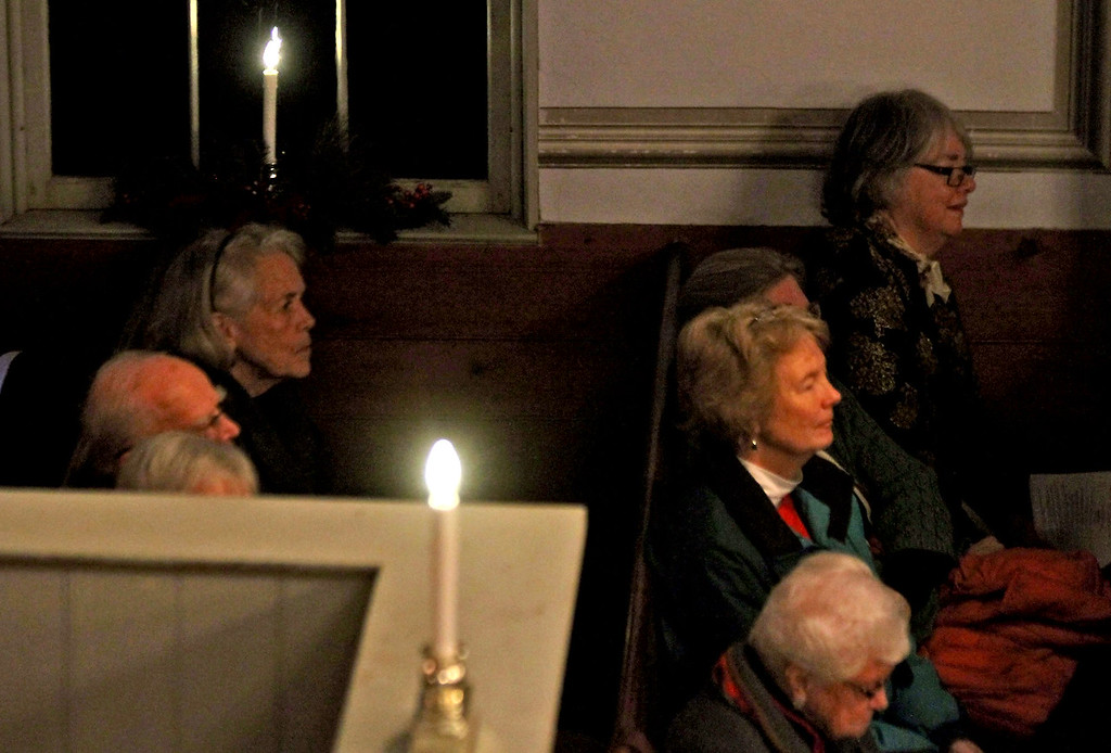 . People listen to the Candlelight Vespers , Bringing Christmas Home program at the Shirley Meeting House. Nashoba Valley Voice/David H. Brow