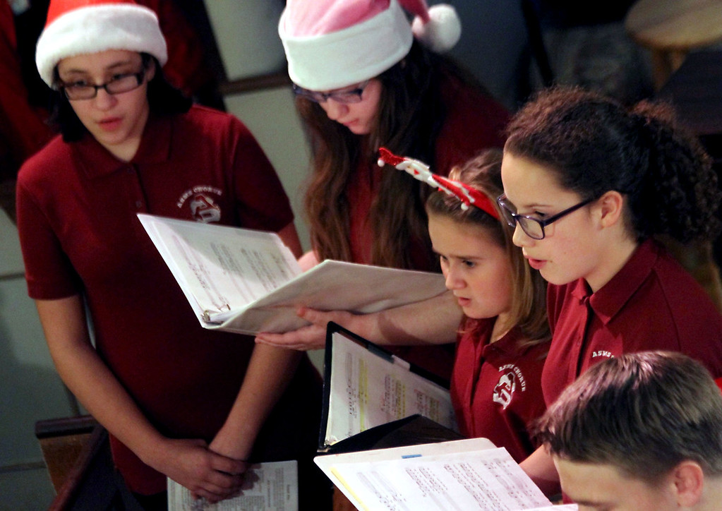 """. Members of the Ayer-Shirley Middle School Chorus preform \"""" In Winter\"""", at Candlelight Vespers in the Shirley Meeting House. Nashoba Valley Voice/David H. Brow"""