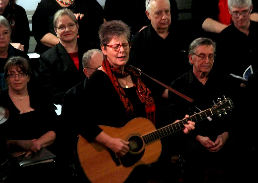 """. Playing a song she wrote, called \""""In Our Home\"""", is Nancy Beaudette at the Candlelight Vespers held at the Shirley Meeting House on Sunday. Nashoba Valley Voice/David H. Brow"""