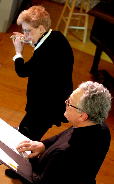 """. Laura Finkelstein plays flute as Paul Przybyla narrates \""""Chanukah Lights and Ner Li(I Have a Candle) for the Candlelight Vespers at Shirley Meeting House. Nashoba Valley Voice/David H. Brow"""