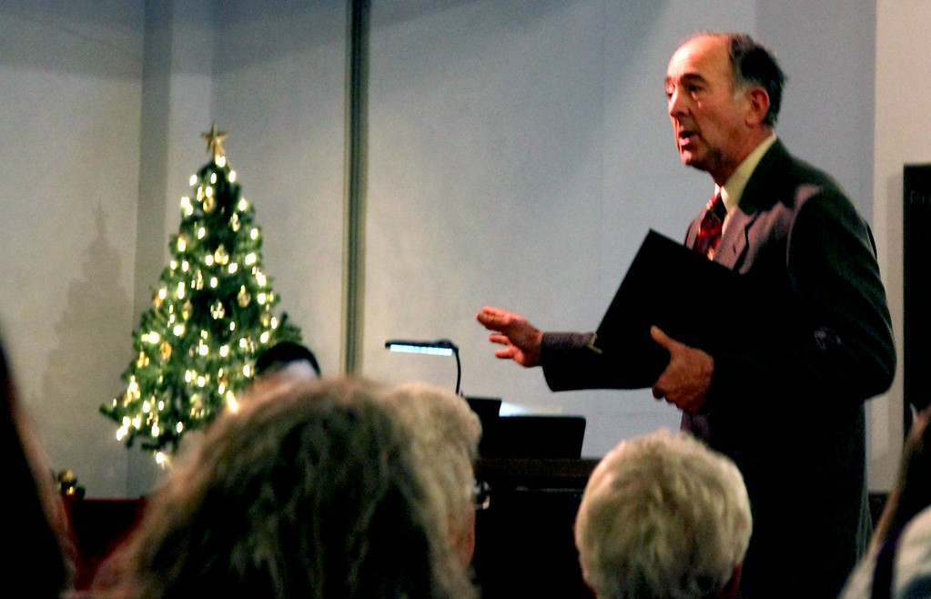 . James Quinty, recites Christmas Bells by Henry Wadsworth Longfellow at Candlelight Vespers at the Shirley Meeting House. Nashoba Valley Voice/David H. Brow