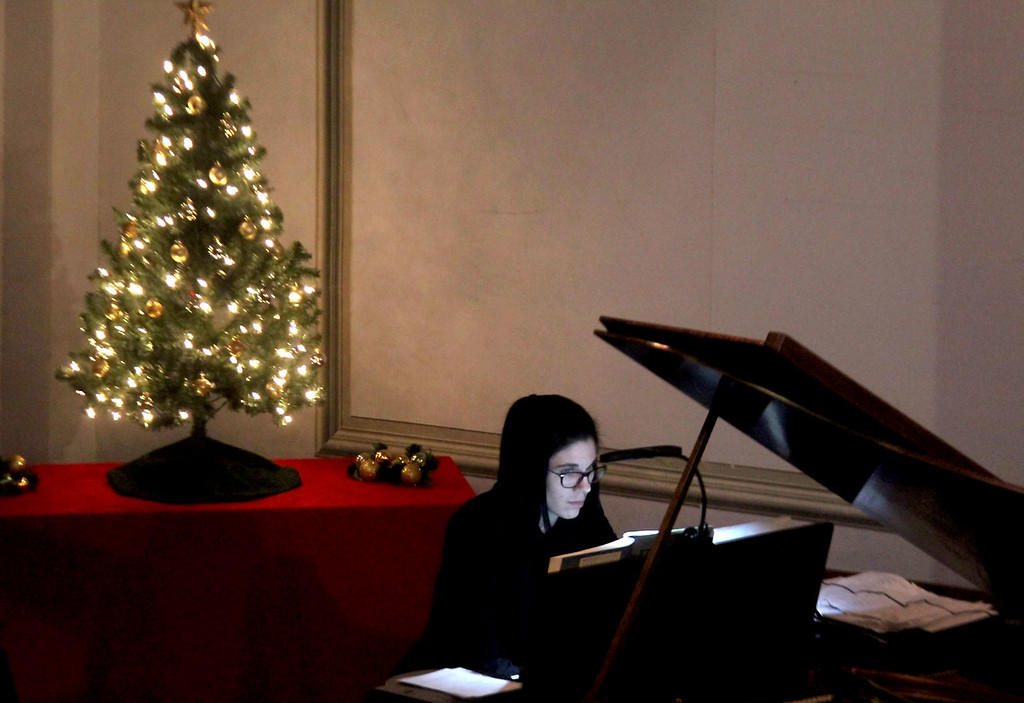 . Here Rene Minalga-Rheault plays Prelude in D-flat major op. 28 no.15, by Fryderyk Chopin, for the Candlelight Vespers, Bringing Christmas Home program. Nashoba Valley Voice/David H. Brow