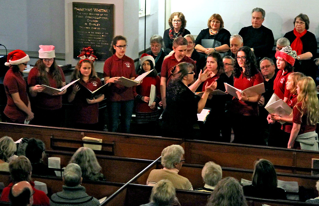 """. Here the Ayer-Shirley Middle School Chorus preforms \""""While the Snow Lay Sleeping\"""" under the direction of Marianne Cooper, at Bringing Christmas Home program at Shirley Meeting House. Nashoba Valley Voice/David H. Brow"""