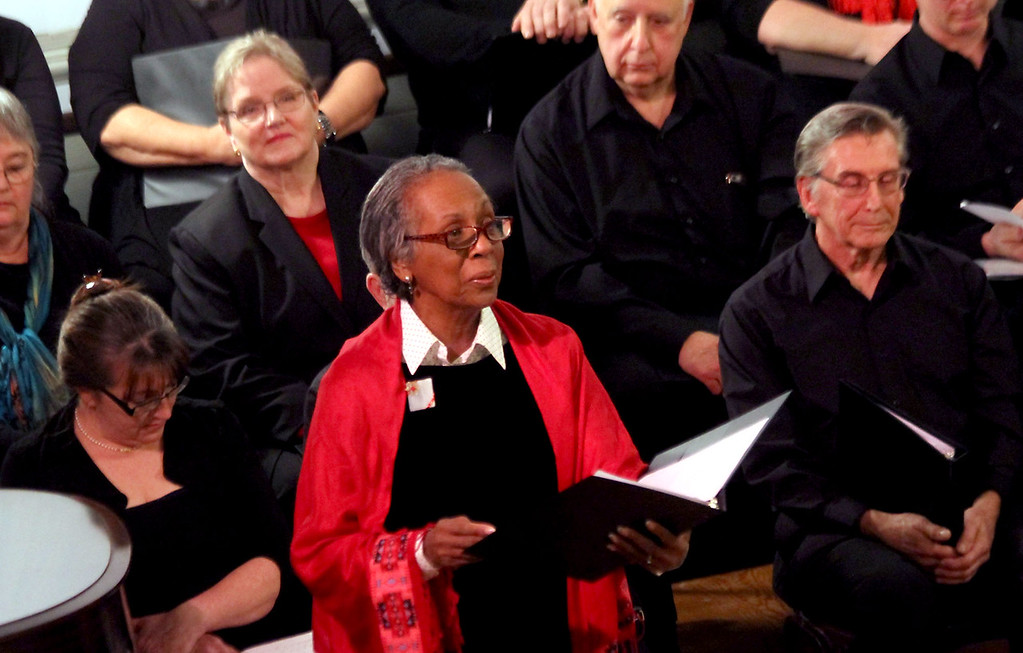 """. Singing  \""""Rose of Bethlehem\"""" is Janice Yancy for the Bringing Christmas Home program of the Candlelight Vespers held at the Shirley Meeting House on Sunday. Nashoba Valley Voice/David H. Brow"""