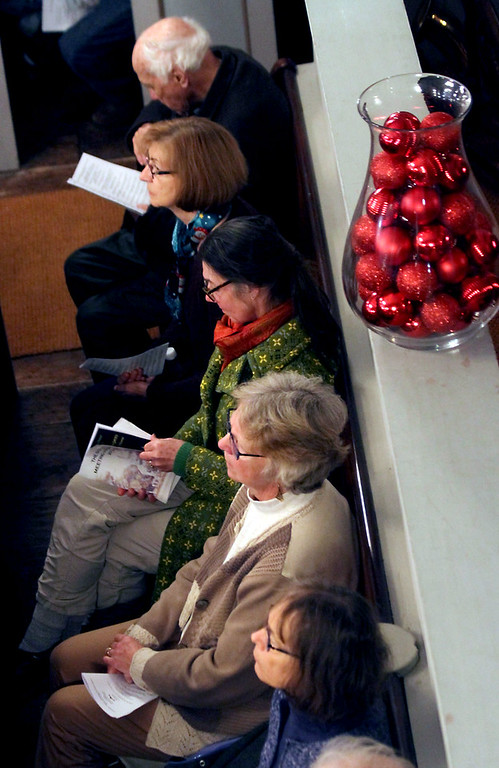 . Folks listen to the Bringing Christmas Home event for the Candlelight Vespers at the Shirley Meeting House. Nashoba Valley Voice/David H. Brow