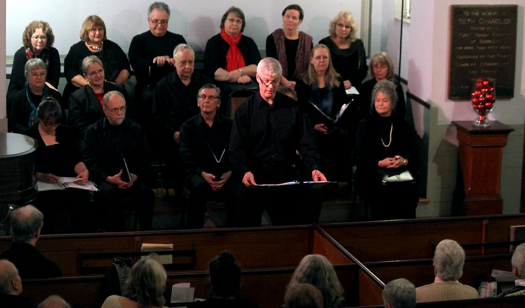 """. Reciting \""""A Visit from St. Nicholas\"""" by Clement Clarke Moore, is Kevin Johnston, at the Candlelight Vespers in the Shirley Meeting House. Nashoba Valley Voice/David H. Brow"""