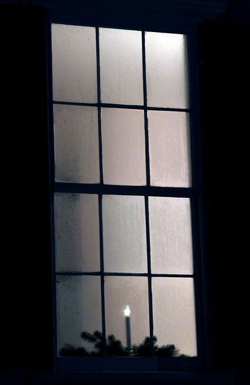 . Candlelit window at the Shirley Meeting House during the Candlelight Vespers. Nashoba Valley Voice/David H. Brow