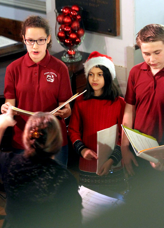 . Some members of the Ayer-Shirley Middle School Chorus preform under direction of Marianne Cooper, at the Candlelight Vespers, Bringing Christmas Home program at the Shirley Meeting House on Sunday. Nashoba Valley Voice/David H. Brow