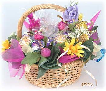 Gift Basket  - Sale Price from $19.95 -  $30.00  Designed in the shape of a little gift basket, this candy bouquet creates a very special mood, especially in romantic situations. Includes 18 chocolates and 1 caramel candy.