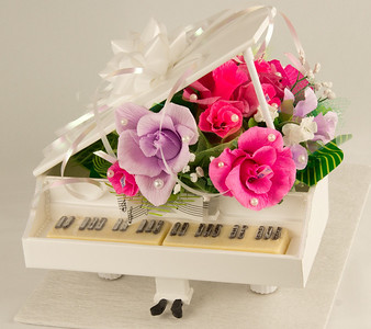 Candy Basket  - Piano - $75.00  The best gift ever for Special Girl!   Every flower include one chocolate candy in the middle of it.  Keyboard made from best chocolate with special order from professional store.