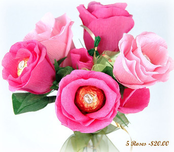 Bouquet of Roses  The quantity of flowers within the bouquet and the color tones of the flowers are designed to order. Let this beautiful bouquet be the center of your next date or the next birthday party  you host. Includes 15 chocolates.