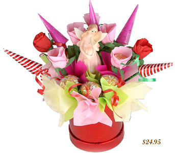 Forest Fairy - SALE! only $19.00     This bouquet, designed in gentle pink and red tones, embodies the dream world of fairies and magical characters that every girl dreams about. In the middle, there is a toy to complete the magical theme of the composition. Includes 16 chocolates.