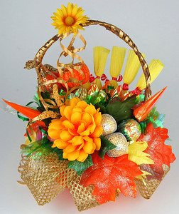 Thanksgiving Bouquet- $45.00    This gift is appropriate for any fall holiday, as it has been designed in traditional fall holiday colors. Includes 30 chocolates candies in paper vase.