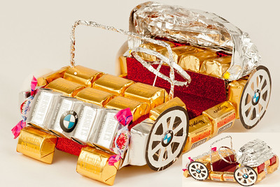 Dream Car - $75.00     If you want to buy a car to your man, you can! BMW made from a lot of candy! Everyone will be happy to get a piece of this car!