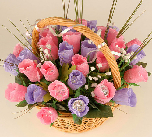 Baskets of Candy Roses - $35.00   This is beautiful bouquet of chocolate roses will make happy every girl  on earth. Includes 35 Hershey's kisses candy.