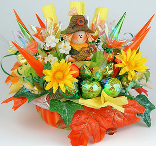 Thanksgiving Bouquet- $45.00    This gift is appropriate for any fall holiday, as it has been designed in traditional fall holiday colors. Includes 30 chocolates and 5 caramel candies in ceramic vase.