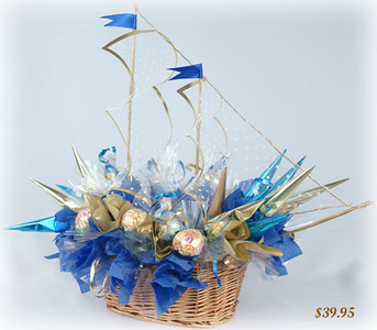 Ship of Dreams  This wonderful bouquet looks like a magic ship catching the wind in its sails. This gift, completed in blue and yellow tones, is appropriate for any occasion, but it is works especially well as a gift for men. Includes 28 chocolates.