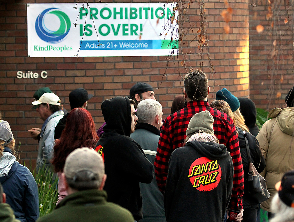 . The first light of day filters through as people wait for the doors to open at KindPeoples marijuana dispensary on Dubois Street in Santa Cruz on Monday to be among the first in California to legally buy recreational marijuana.