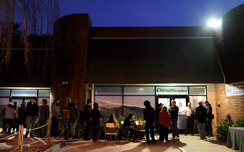 . Customers wait in the predawn cold at Kind Peoples marijuana dispensary on Dubois Street in Santa Cruz Monday to be among the first to legally purchase recreational marijuana in California. (Shmuel Thaler -- Santa Cruz Sentinel)