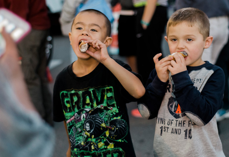 Caleb Warpula, 5, and Aaron Ouellette, 5, enjoy some cannolis during the cannoli festival in downtown Leominster on Thursday evening. SENTINEL & ENTERPRISE / Ashley Green