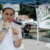 Liz Sallese fills cannolis from Stillman Farm during the cannoli festival in downtown Leominster on Thursday evening. SENTINEL & ENTERPRISE / Ashley Green