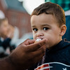 Nicholas Vasquez, 2, snacks on a cannoli during the cannoli festival in downtown Leominster on Thursday evening. SENTINEL & ENTERPRISE / Ashley Green