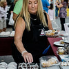 Ellen Fay Corliss fills cannoli orders from Aunty Ellen's during the cannoli festival in downtown Leominster on Thursday evening. SENTINEL & ENTERPRISE / Ashley Green