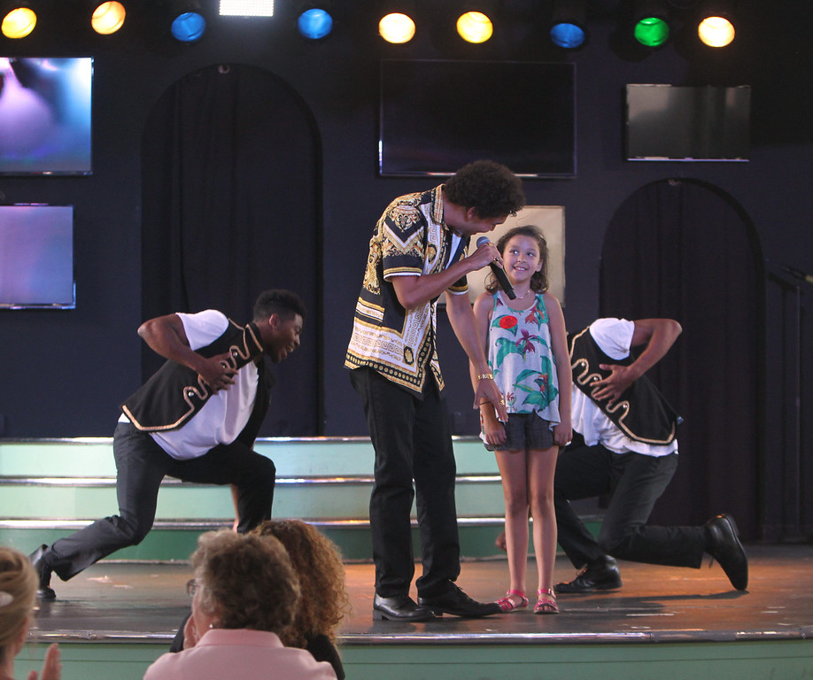 . Canobie Lake Park in Salem, N.H. Scarlett Messick, 9, of Lexinton, is invited to the stage by Tribute to Bruno act. (SUN/Julia Malakie)