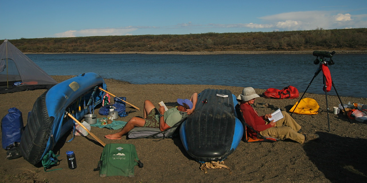 "We name all our camps. This is called ""Fish Camp"". This camp is typical of many of our camps. It is on a flat beach covered with small round pebbles. We have lots of time to relax. No mosquitos yet. They will appear later."