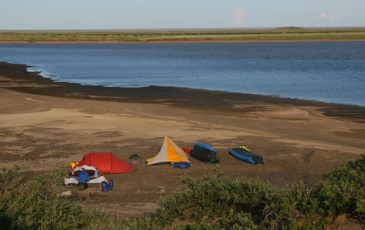 """Camp 25 - Pingo View Camp - The """"pingo"""" in the upper right, is a small hill formed by ice under the tundra."""