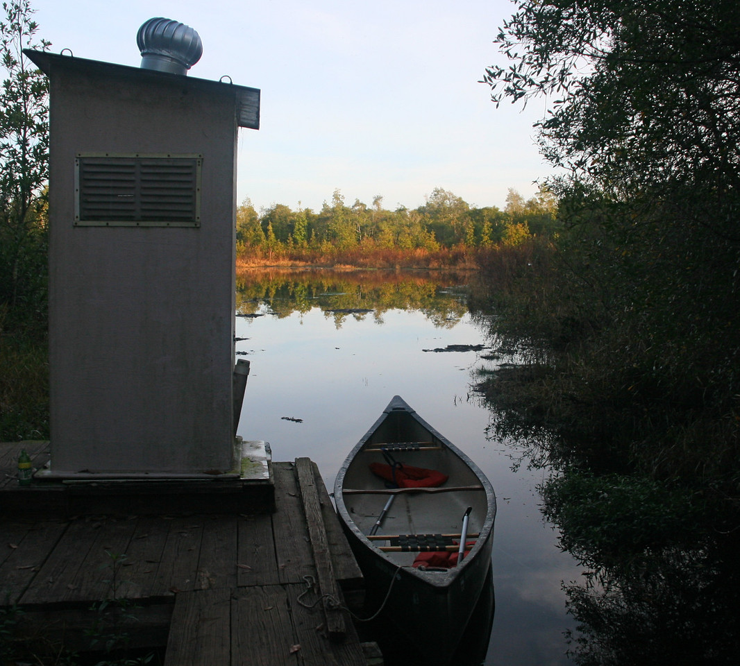 A walkway leads to our canoe and a composting toilet.