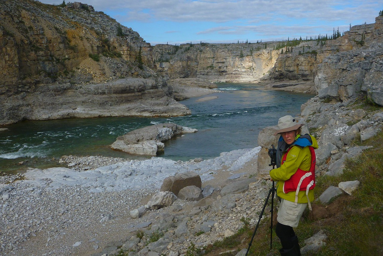 Day 13 - Louisa is setting up to film the boats running this relatively easy rapid. After the rapid, we will quickly land on the left bank to scout the next one that you can see in the upper center. The next  rapid is the crux.