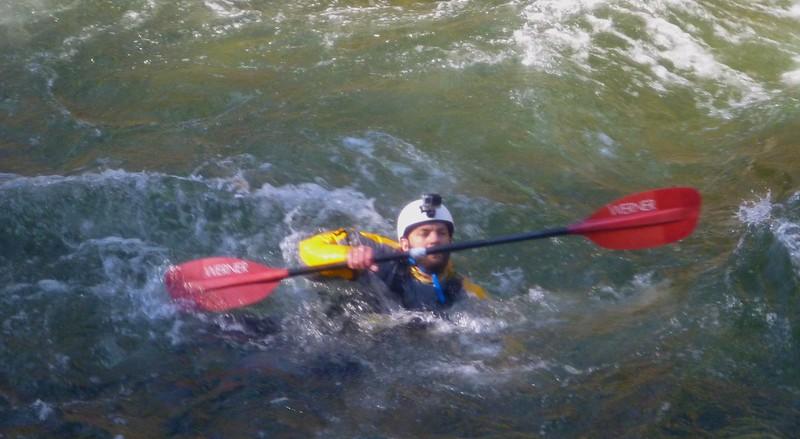 Dan swimming after his boat.