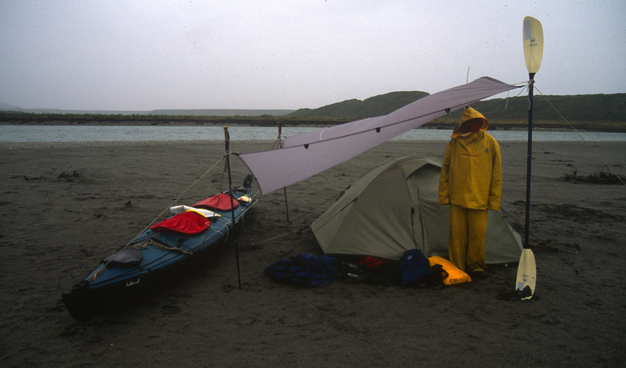 The rain begins. Note John and Karin's excellent tarp design. The river behind has increased in volume.