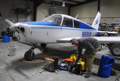 Packing gear at bush pilot Jim Kincaid's  hanger.