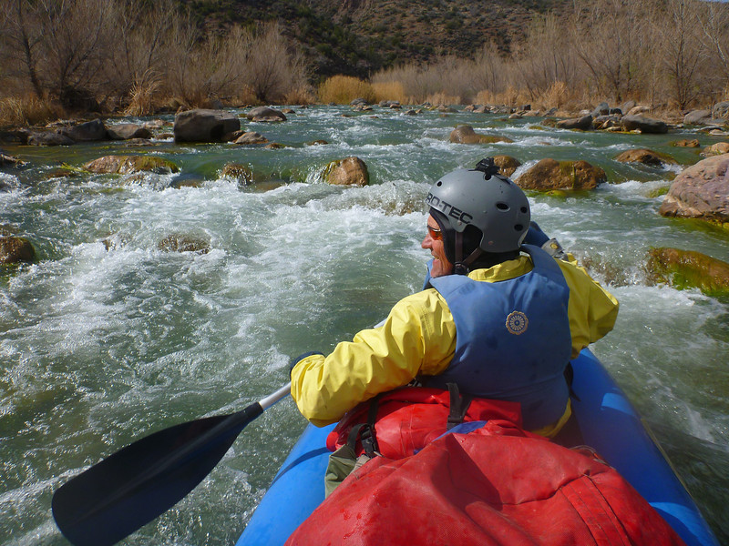 Our water levels are low enough that there are always rocks showing in the rapids. Here we are lodged on one and looking up stream as we try to push off.