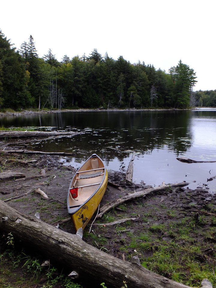Whatnot Lake is the top of the watershed, and a crossroads. Behind the canoe is the portage back to McGarvey...