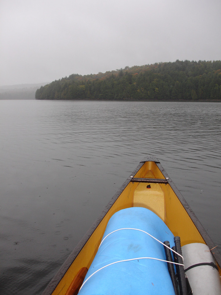 Next day.  Setting out across Ragged Lake in the drizzle, en route to Big Porcupine Lake.